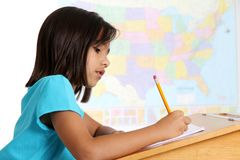 Elementary Girl In School. Elemantary aged girl in her school classroom Stock Photo