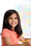 Elementary Girl In School. Elemantary aged girl in her school classroom Stock Photos