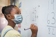 Free Elementary Girl Wearing Mask At School Stock Photos - 197068663