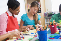 Elementary pupil in art class. With teacher Royalty Free Stock Images