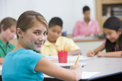 Elementary pupil in school classroom. Female elementary pupil in school classroom Royalty Free Stock Image