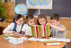 Elementary pupils in classroom royalty free stock images