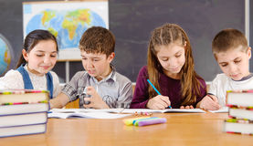 Elementary pupils in classroom during lesson Stock Image