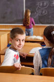 Elementary pupils in classroom during lesson Royalty Free Stock Photos