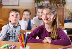 Elementary pupils in classroom during lesson Stock Photos