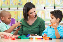 Elementary Pupils Counting With Teacher In Classroom Stock Photography
