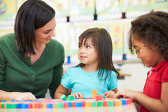 Elementary Pupils Counting With Teacher In Classroom royalty free stock photography