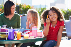 Elementary Pupils And Teacher Eating Lunch Stock Photos
