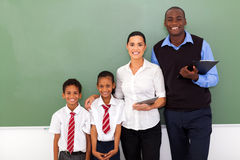 Elementary school. Group of elementary school teachers and students Royalty Free Stock Photos