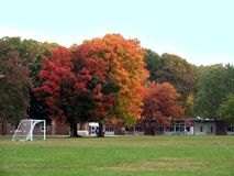 Elementary School in Autumn. Fall foliage at an elementary school shows a soccer goal royalty free stock photo