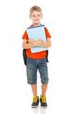Elementary school boy. Cute elementary school boy holding books on white background Royalty Free Stock Photos
