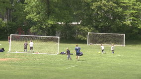 Elementary School Boys Playing Soccer (6 of 6). A view or scene of Sports stock video