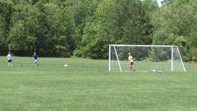 Elementary School Boys Playing Soccer (2 of 6). A view or scene of Sports stock video