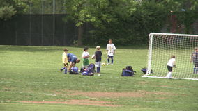 Elementary School Boys Playing Soccer (4 of 6). A view or scene of Sports stock video