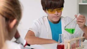 Elementary school chemistry class stock video