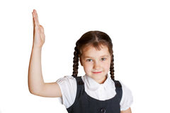 Elementary school child raising her hand up. Royalty Free Stock Image