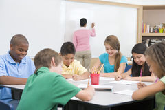 Elementary School Clasroom With Teacher Royalty Free Stock Photography