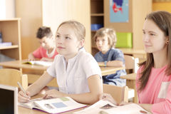 Elementary school classroom. Elementary school group reading in the classroom Stock Photography