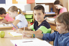 Elementary school classroom. Elementary school group sitting and writing test Royalty Free Stock Photo