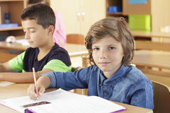 Elementary school classroom. Elementary school group writing test Royalty Free Stock Photography
