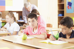 Elementary school classroom. Teacher helping elementary school group Royalty Free Stock Images
