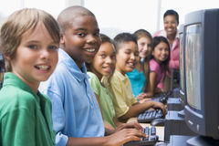 Elementary school computer class. Looking to camera