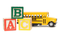 Elementary School Concept. Concept image of elementary school using a toy school bus and baby letter blocks Royalty Free Stock Photo
