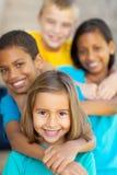 Elementary school friends. Happy elementary school friends outdoors Royalty Free Stock Image