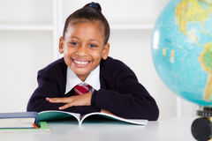 Elementary school girl. Happy elemantary school girl in classroom Stock Images