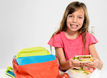 Elementary school girl about to eat her packed lunch Royalty Free Stock Image