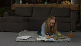Elementary school girl writing her homework stock footage