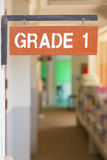Elementary school, grade 1 sign. Elementary school, grade one sign at corridor outside of classrrom in the morning Stock Image