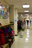 Elementary school hallway. Coats, backpacks and children's artwork line the hallway of an elementary school Royalty Free Stock Photo