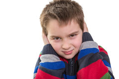 Elementary School Kid Disturbed by Sound Royalty Free Stock Image