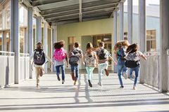 Elementary school kids running at school, back view close up stock photography