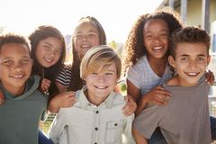 Elementary school kids smiling to camera during school break royalty free stock photos