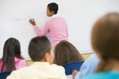 Elementary school maths class. Elementary school teacher holding maths class Royalty Free Stock Photos