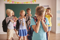 Elementary school. Picture showing children violence  at school Stock Photos