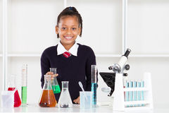 Elementary school pupil. Happy female elemantary school pupil in science class Royalty Free Stock Photo