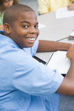 Elementary school pupil. Working at desk Royalty Free Stock Images