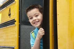 Elementary School Pupil Board Bus Stock Images