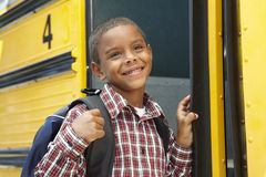 Elementary School Pupil Boarding Bus Stock Images