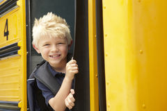 Elementary School Pupil Boarding Bus Stock Photos