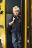 Elementary School Pupil Boarding Bus Stock Photo