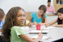 Elementary school pupil in classroom Stock Images