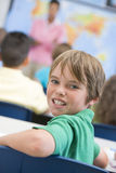 Elementary school pupil in classroom Royalty Free Stock Image