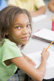 Elementary school pupil at desk Royalty Free Stock Images