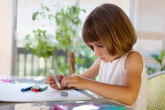 Elementary school pupil homeworking at desk Royalty Free Stock Images