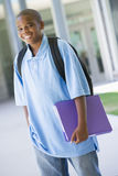 Elementary school pupil outside. Carrying folder Royalty Free Stock Images