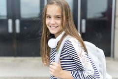 Elementary school pupil outside carrying rucksack Royalty Free Stock Photography
